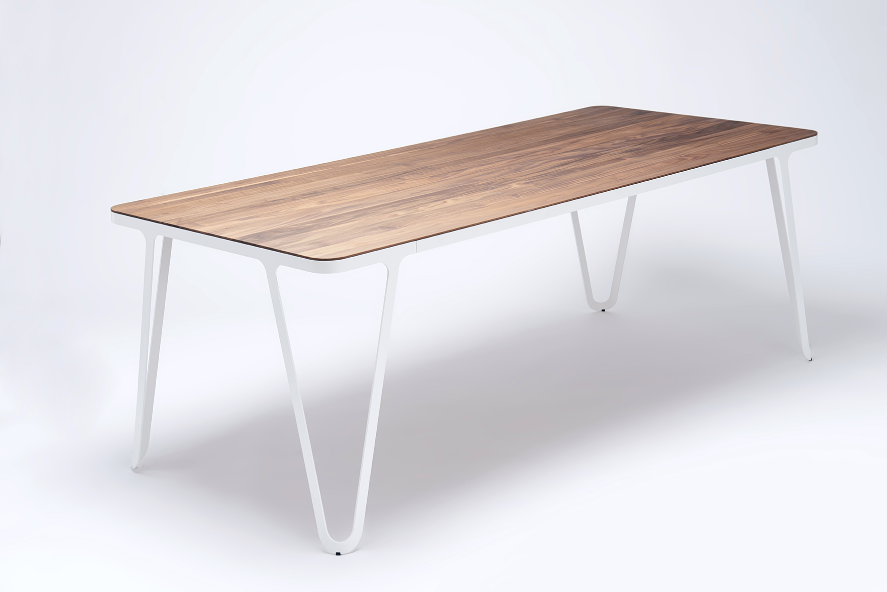 Futuristic shaped aluminium table frame with solid wood top
